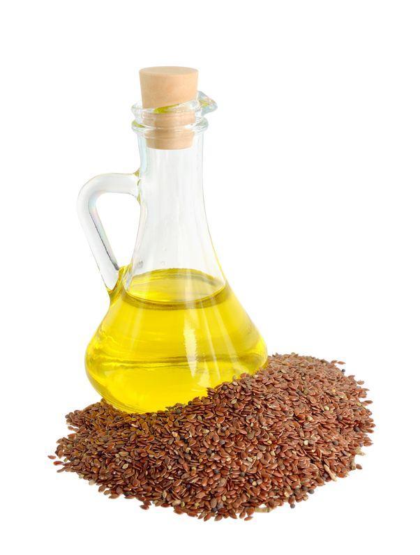 huile de lin entourée de graines de lin